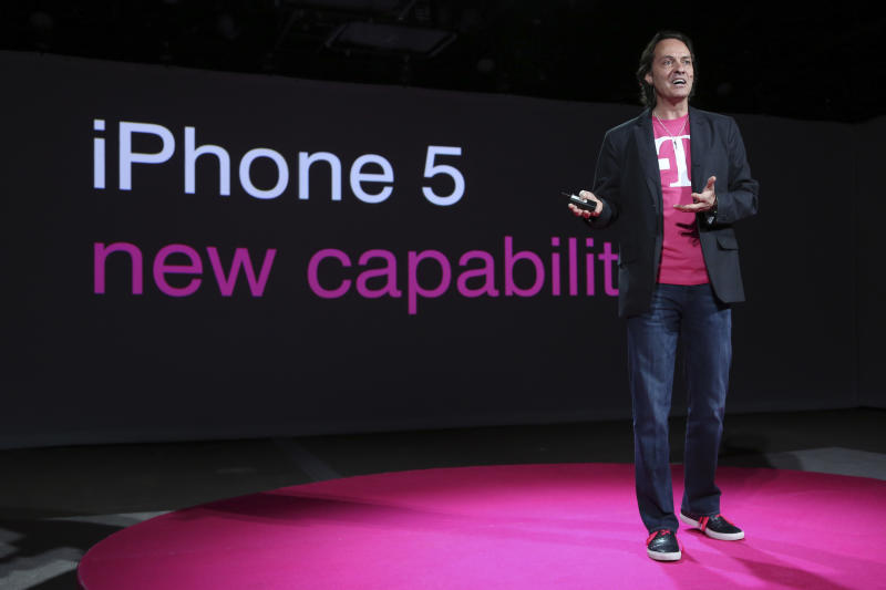 """T-Mobile CEO John Legere speaks during a news conference Tuesday, March 26, 2013 in New York. T-Mobile will start offering the iPhone 5 on April 12, filling what Legere said was """"a huge void"""" in its phone lineup. The company is currently the only major U.S. carrier not to offer Apple's popular smartphone. (AP Photo/Mary Altaffer)"""