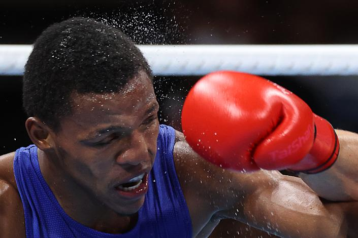 <p>The Dominican Republic's Euri Cedeno Martinez competes in a men's middleweight (69-75kg) quarterfinal boxing bout against Ukraine's Oleksandr Khyzhniak at Kokugikan Arena during the 2020 Summer Olympic Games. Khyzhniak won the bout. Valery Sharifulin/TASS (Photo by Valery Sharifulin\TASS via Getty Images)</p>