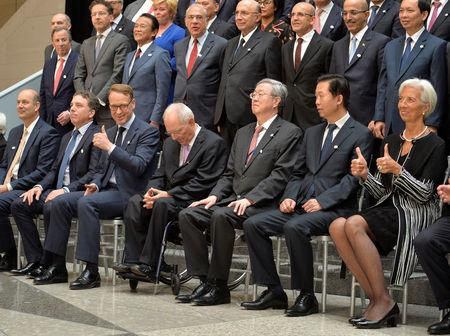 IMF Managing Director Christine Lagarde (R) and Bundesbank President Jens Weidmann (3rd L) give thumbs up after posing with ministers and bank governors for a family photo during the IMF and World Bank's 2017 Annual Spring Meetings, in Washington, U.S., April 21, 2017.      REUTERS/Mike Theiler