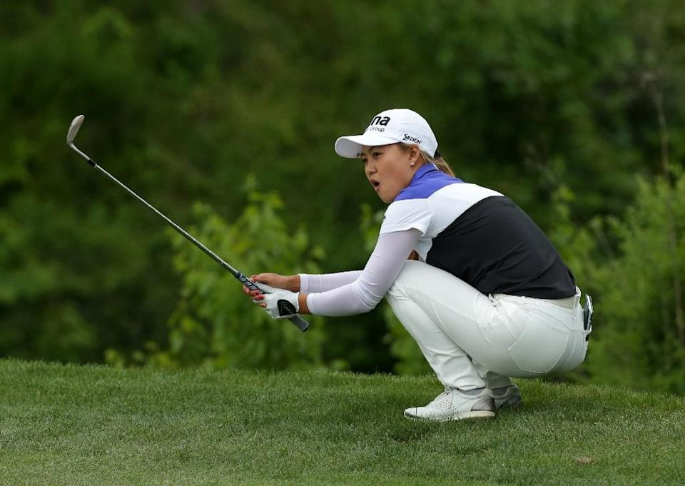Minjee Lee of Australia reacts after hitting her third shot on the 18th hole during the first round of the Kingsmill Championship on May 19, 2016 in Williamsburg, Virginia (AFP Photo/Hunter Martin)
