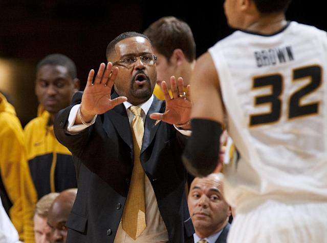 Missouri head coach Frank Haith, left, slows down player Jabari Brown, right, as he brings the ball up court during the second half of an NCAA college basketball game against Vanderbilt, Wednesday, Feb. 19, 2014, in Columbia, Mo. Missouri won the game 67-64. (AP Photo/L.G. Patterson)
