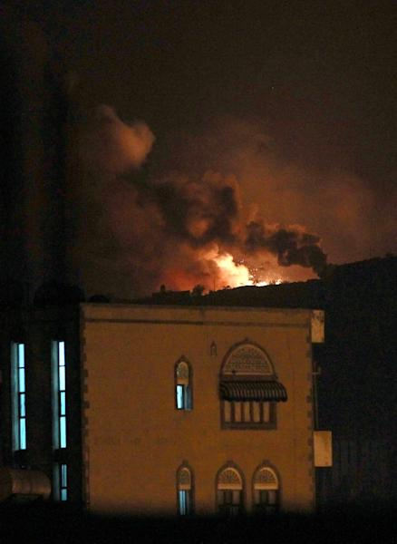 Smoke and flames rise from an alleged weapons storage depot at a Shiite Huthi rebel camp after an airstrike by the Saudi-led alliance on March 30, 2015 in the Yemeni capital Sanaa (AFP Photo/Mohammed Huwais)
