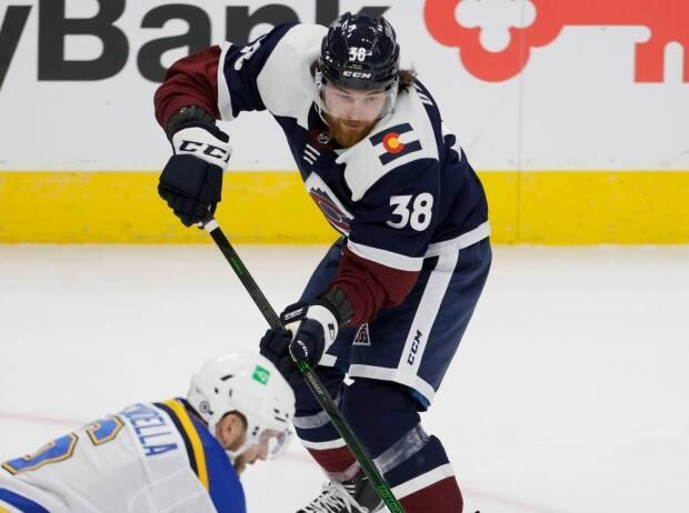 O'Brien chips the puck over St. Louis Blues defenceman Marco Scandella's stick in the first period of an NHL hockey game in Denver on Friday.