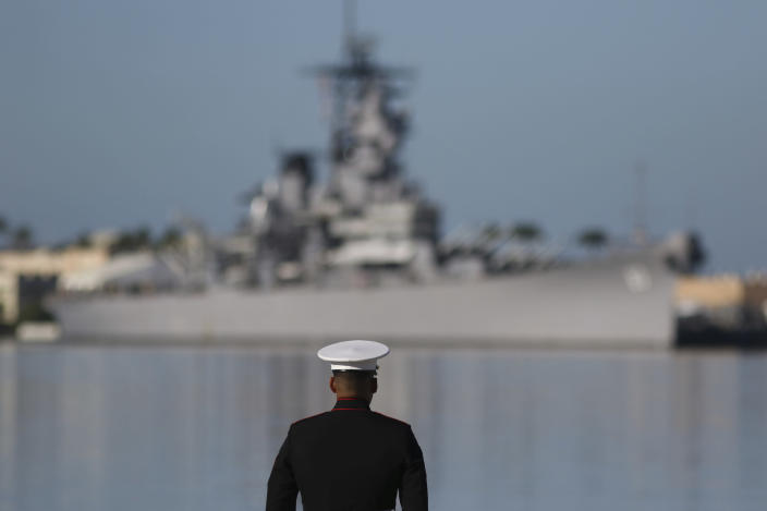 A U.S. Marine stands in front of the USS Missouri during a ceremony to mark the 78th anniversary of the Japanese attack on Pearl Harbor, Saturday, Dec. 7, 2019 at Pearl Harbor, Hawaii. Survivors and members of the public gathered in Pearl Harbor to remember those killed when Japanese planes bombed the Hawaii naval base 78 years ago and launched the U.S. into World War II. About a dozen survivors of the attack attended the annual ceremony, the youngest of whom are now in their late 90s. (AP Photo/Caleb Jones)
