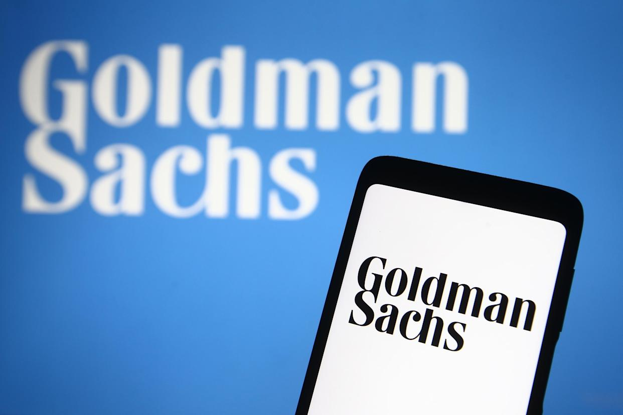 In this photo illustration the Goldman Sachs logo of the U.S. investment bank is seen on a smartphone and a pc screen. (Photo by Pavlo Gonchar / SOPA Images/Sipa USA)