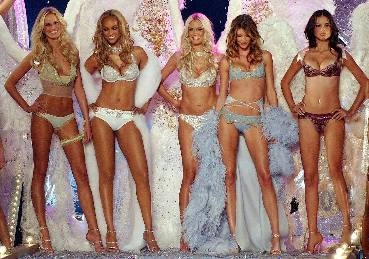 FILE - In this Nov. 13, 2003 file photo, models, from left, Karolina Kurkova of the Czech Republic, Tyra Banks of the U.S., Heidi Klum of Germany, Gisele Bundchen of Brazil, and Adriana Lima of Brazil pose in lingerie at the Victoria's Secret fashion show. Kurkova, who was on the cover of Vogue when she was 16, now mentors young models and on Tuesday, Feb. 7, 2012, participated in a panel discussion hosted by the Council of Fashion Designers of America to discuss model health and workplace respect.(AP Photo/Louis Lanzano, File)