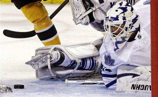 Toronto Maple Leafs goalie Ben Scrivens twists as he looks back at the puck before making a save against the Boston Bruins during the second period of an NHL hockey game in Boston, Thursday, March 7, 2013. (AP Photo/Charles Krupa)