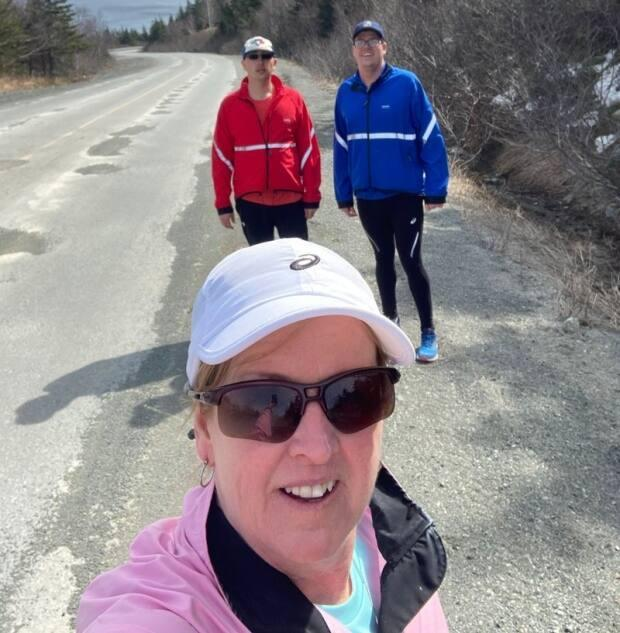 Bradley Murphy, left and Shane Mahon recently completed a 42-kilometer run that brought them across the Southern Shore. (Bay Bulls-Bauline Athletic Association/Facebook - image credit)