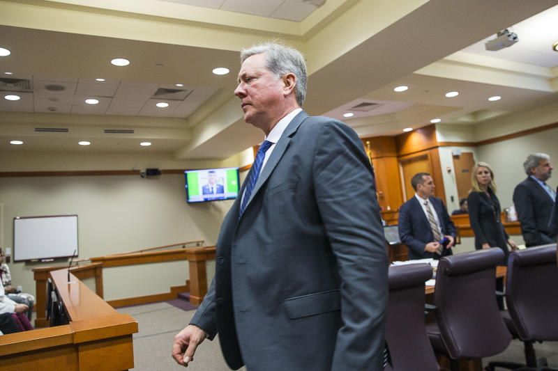Former DeKalb County police officer Robert Olsen becomes emotional during his sentencing, Friday, Nov. 1, 2019, in Decatur, Ga.. Olsen, who was convicted of aggravated assault and other crimes in the fatal shooting of an unarmed, naked man, was sentenced Friday to 12 years in prison.. (Alyssa Pointer/Atlanta Journal-Constitution via AP)