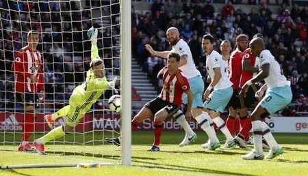 Britain Soccer Football - Sunderland v West Ham United - Premier League - Stadium of Light - 15/4/17 West Ham United's James Collins scores their second goal Action Images via Reuters / Ed Sykes Livepic