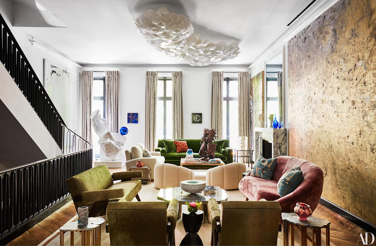 """<div class=""""caption""""> The living room of Allison and Warren Kanders's New York City townhouse features contemporary artworks by (from left) Christopher Wool, Jeff Koons, Gabriel Orozoo, Paul McCarthy, and Rudolf Stingel alongside vintage furniture. </div>"""