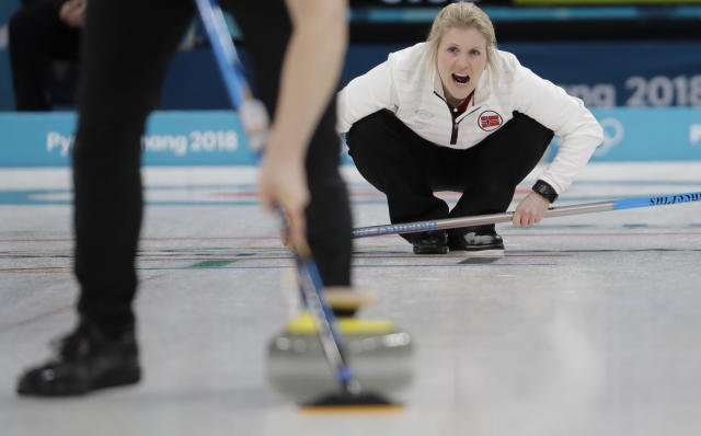 Norway's Kristin Skaslien watches her teammate Magnus Nedregotten sweep the ice during a mixed double curling match against Canada's Kaitlyn Lawes and John Morris at the 2018 Winter Olympics in Gangneung, South Korea, Thursday, Feb. 8, 2018. (AP Photo/Natacha Pisarenko)