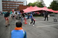 Howzat? Fans play an impromptu game of cricket at Old Trafford in the absence of any Test action (AFP/Oli SCARFF)