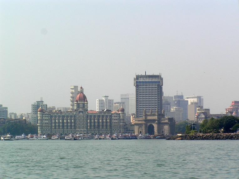 <p>India's financial capital, Mumbai, is known for its resilient nature and entrepreneurial mindset. In fact, a major reason for India's big leap in the ease of doing business index is the reforms taken by the Maharashtra government. The Maharashtra Government has reduced the time frame for getting clearances from 160 days to 60 days, the number of permissions required for constructing a building has been reduced from 42 to 8 and electricity connections are now provided within nine days. Companies such as Larson & Toubro, Tata Group, Godrej and Reliance are all headquartered in Mumbai.<br /><br />Real estate prices and infrastructure which has not caught up with industrial growth, remain bottlenecks in the city. However, upcoming projects such as the Coastal Road which will connect South Mumbai with the western suburb of Kandivali, the Goregaon-Mulund Link road, connecting the western and eastern suburbs, the Mumbai-Trans harbour link which will connect Sewri in South Mumbai to Nhava Seva port in Navi Mumbai, are expected to ease traffic once completed and boost business further.<br /><br />By Elroy Serrao (Mumbai Skyline) [CC BY-SA 2.0 (https://creativecommons.org/licenses/by-sa/2.0)], via Wikimedia Commons </p>