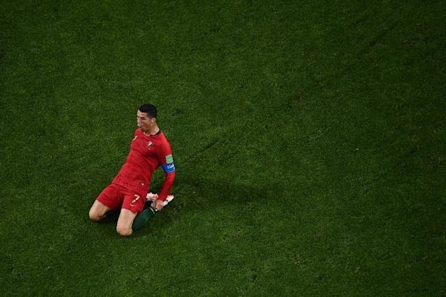 Ronaldo celebrates after scoring one of his three goals against Spain to become only the fourth player to score in four World Cups (AFP Photo/Jewel SAMAD)
