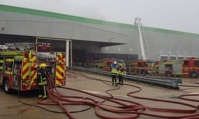 Fire at Ocado's automated warehouse halts customer deliveries