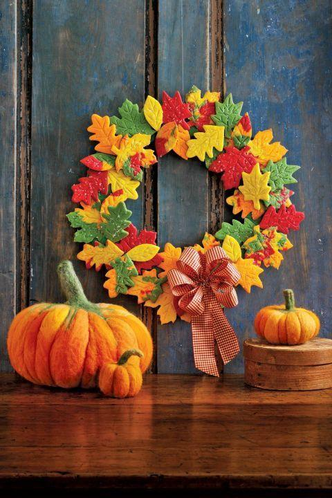 """<p>The blazing color palette of autumn takes the spotlight in this seasonal display of needle-felted pumpkins and an edible cookie wreath. </p><p><strong><a href=""""https://www.countryliving.com/diy-crafts/how-to/g1732/fall-cookie-wreath/"""" rel=""""nofollow noopener"""" target=""""_blank"""" data-ylk=""""slk:Get the tutorial."""" class=""""link rapid-noclick-resp"""">Get the tutorial.</a></strong></p>"""