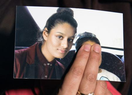 FILE PHOTO: Renu Begum, sister of teenage British girl Shamima Begum, holds a photo of her sister as she makes an appeal for her to return home at Scotland Yard, in London