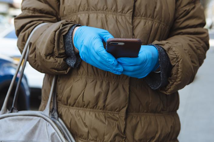 A person wears protective gloves