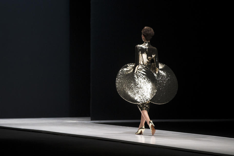FILE - In this March 22, 2016 file photo, a model displays a creation by French fashion designer Pierre Cardin during Moscow Fashion Week, Russia. Pierre Cardin, the French designer whose famous name embossed myriad consumer products after his iconic Space Age styles shot him into the fashion stratosphere in the 1960s, has died, the French Academy of Fine Arts said Tuesday. He was 98.(AP Photo/Pavel Golovkin, File)