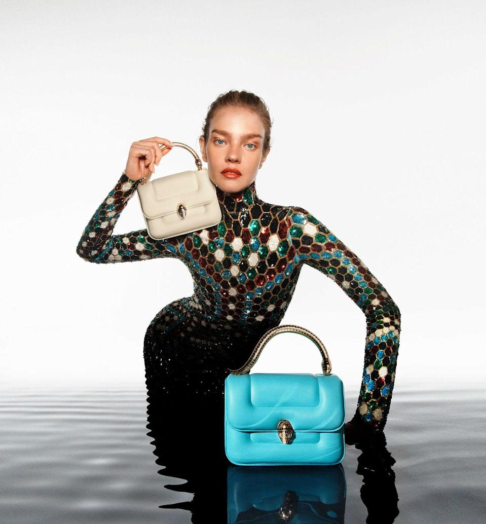 """<p><strong>Who:</strong> BVLGARI<br><strong><br>What: </strong>Collaboration with Mary Katrantzou</p><p><strong>Where: </strong>Available for pre-order in selected Bvlgari boutiques worldwide and on Bulgari.com from April 15. Online pre-orders will start from March 21st.</p><p><strong>Why: </strong>Bvlgari has allowed another designer to reimagine the iconic Bvlgari Serpenti and infuse their personal style and taste into the original design. British-born Greek designer Mary Katrantzou, known for her intricate and colorful designs, reworked on the Serpenti Metamorphosis bag, the Serpenti Metamorphosis Handle bag and the Serpenti Metamorphosis <em>minaudière. </em>Katrantzou emphasizes the relationship between the butterfly and snake with her playful patterns. Pictured here on fashion icon Natalia Vodianova, the Serpenti Metamorphosis Handle bag is reimagined in sublime Nappa leather in a variety of new colors. </p><p><a class=""""link rapid-noclick-resp"""" href=""""https://go.redirectingat.com?id=74968X1596630&url=https%3A%2F%2Fwww.bulgari.com%2Fen-us%2Fbags-and-accessories%2Fbvlgari-highlights%2Fmary-katrantzou-x-bvlgari%2F&sref=https%3A%2F%2Fwww.elle.com%2Ffashion%2Fshopping%2Fg35685914%2Fmarch-2021-fashion-collaborations-launches%2F"""" rel=""""nofollow noopener"""" target=""""_blank"""" data-ylk=""""slk:PRE-ORDER HERE"""">PRE-ORDER HERE</a></p>"""