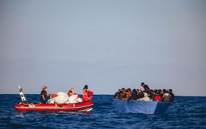 File image of a migrant dinghy attempting to cross the Mediterranean Sea into Europe - AFP