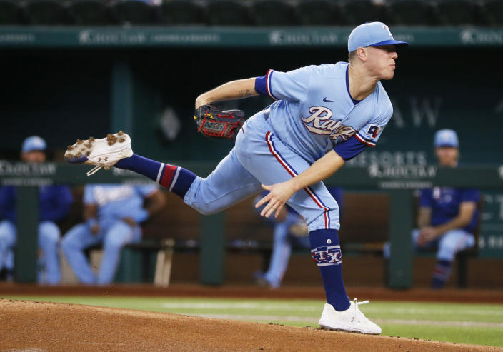 Texas Rangers starting pitcher Kolby Allard throws to the plate against the Oakland Athletics during the first inning of a baseball game in Arlington, Texas, Sunday, July 11, 2021. (AP Photo/Ray Carlin)