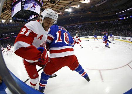 Mar 19, 2019; New York, NY, USA; Detroit Red Wings center Frans Nielsen (51) battles for the puck with New York Rangers defenseman Marc Staal (18) during the first period at Madison Square Garden. Mandatory Credit: Adam Hunger-USA TODAY Sports