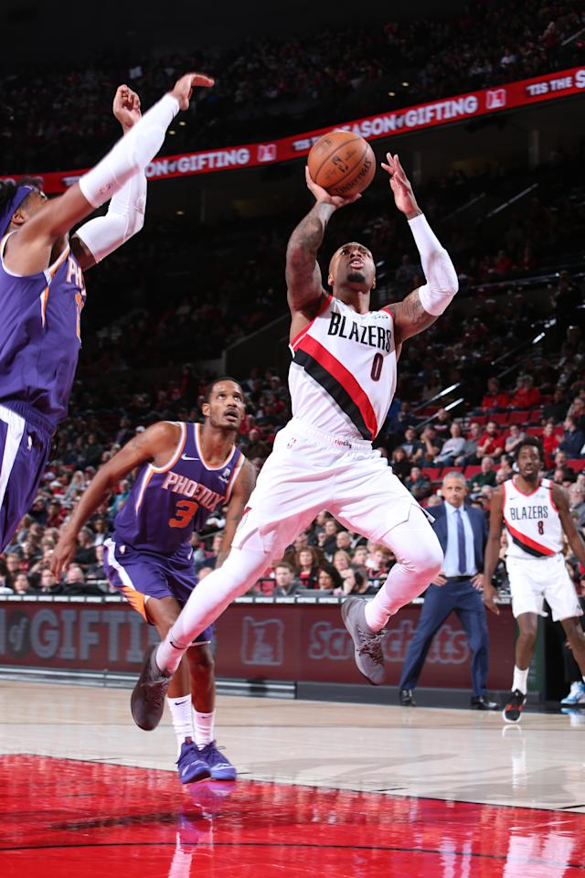 PORTLAND, OR - DECEMBER 6: Damian Lillard #0 of the Portland Trail Blazers shoots the ball against the Phoenix Suns on December 6, 2018 at the Moda Center Arena in Portland, Oregon. (Photo by Sam Forencich/NBAE via Getty Images)