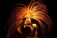 Measures such as face masks and a smaller audience enabled the show and its flamboyant costumes to survive the pandemic