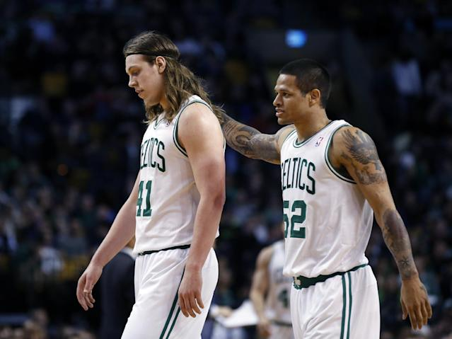 Boston Celtics center Kelly Olynyk (41) and guard Chris Babb (52) walk to the bench during a time out in the fourth quarter of an NBA basketball game against the Golden State Warriors in Boston, Wednesday, March 5, 2014. The Warriors won 108-88. (AP Photo/Elise Amendola)