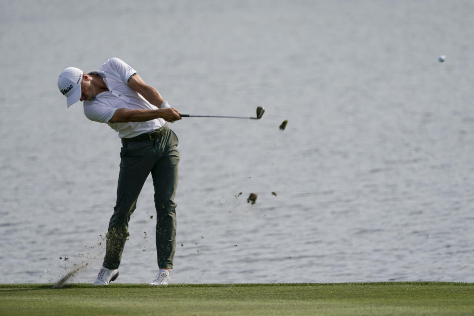 Justin Thomas hits from the fairway on the 18th hole during the third round of The Players Championship golf tournament Saturday, March 13, 2021, in Ponte Vedra Beach, Fla. (AP Photo/John Raoux)