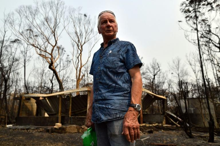 Ken Stewart, 79, tried to defend his home from a bushfire but was forced to flee a wall of flames