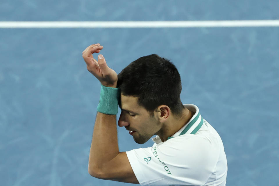 Serbia's Novak Djokovic reacts after a point against Canada's Milos Raonic during their men's singles match on day seven of the Australian Open tennis tournament in Melbourne on February 14, 2021. (Photo by David Gray / AFP) / -- IMAGE RESTRICTED TO EDITORIAL USE - STRICTLY NO COMMERCIAL USE -- (Photo by DAVID GRAY/AFP via Getty Images)
