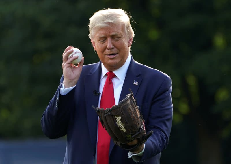Trump plays catch with pitcher Mariano Rivera to mark baseball opening
