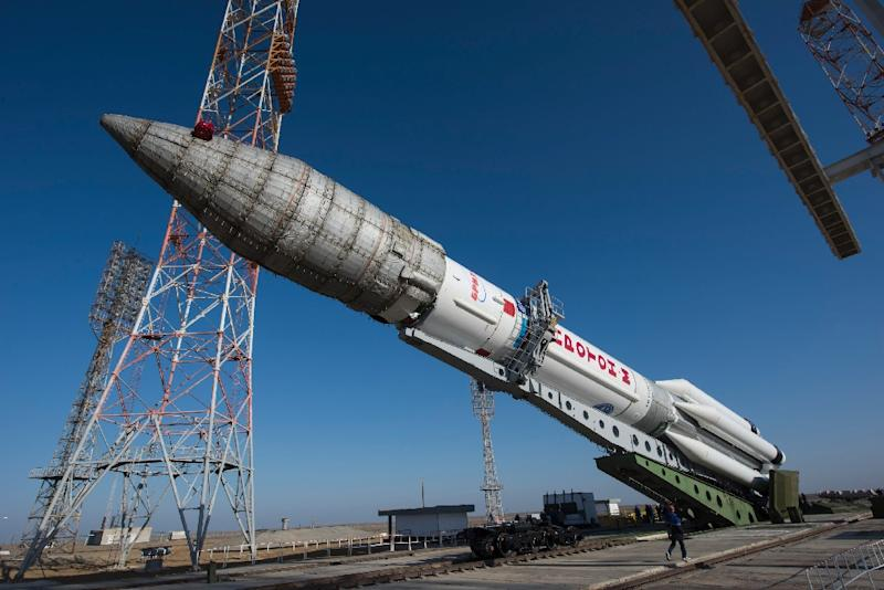 Picture released by the European Space Agency shows the Russian Proton rocket that will launch the ExoMars 2016 spacecraft during its transfer to the launch pad (AFP Photo/Stephane Corvaja)