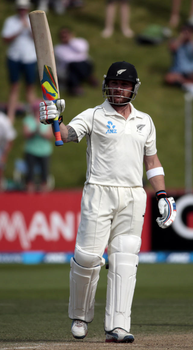 New Zealand's Brendon McCullum acknowledges his 250 against India during the second innings on day four of the second international test cricket match at the Basin Reserve in Wellington, February 17, 2014. REUTERS/Anthony Phelps (NEW ZEALAND - Tags: SPORT CRICKET)