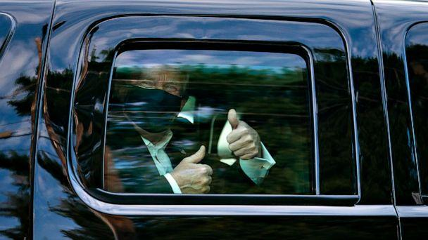 PHOTO: President Donald Trumpm who tested positive for COVID-19, greets supporters during a drive by outside of Walter Reed National Military Medical Center, Oct. 4, 2020, in Bethesda, Md. (Tia Dufour/White House )