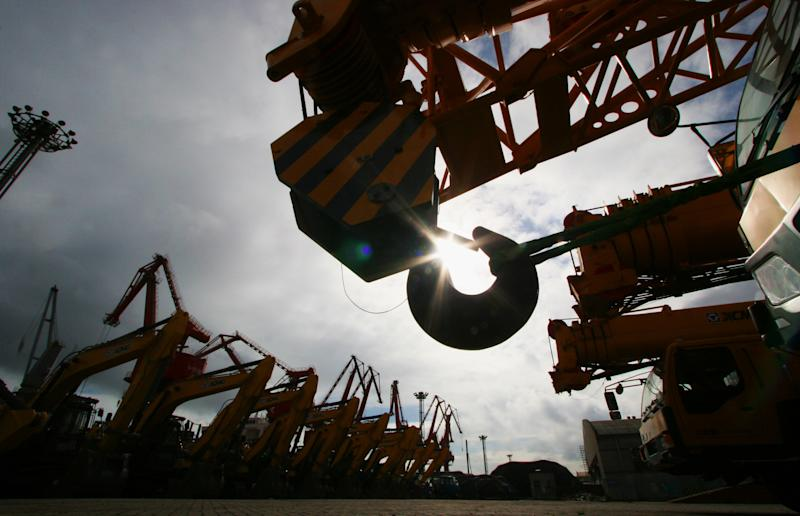 Cranes made in China waiting to be exported from Lianyungang port, eastern China's Jiangsu province, on August 1, 2014
