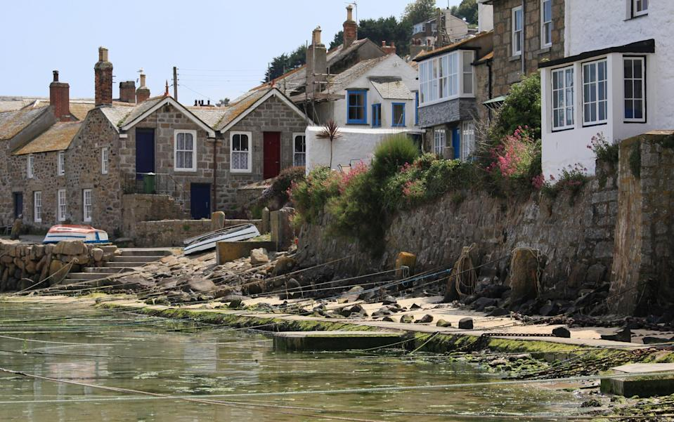 "<p>The fishing village of Mousehole is nestled between Newlyn and Lamorna on the western coast of Cornwall. A quiant <a href=""http://no5mousehole.co.uk/"" rel=""nofollow noopener"" target=""_blank"" data-ylk=""slk:cottage"" class=""link rapid-noclick-resp"">cottage</a> with white-washed walls will provide a cosy night in after a day spent exploring the cobbled streets. <a href=""https://www.tripadvisor.co.uk/Restaurant_Review-g186238-d2091179-Reviews-Jessie_s_Dairy-Mousehole_Cornwall_England.html"" rel=""nofollow noopener"" target=""_blank"" data-ylk=""slk:Jessie's Dairy"" class=""link rapid-noclick-resp"">Jessie's Dairy</a> is an essential afternoon pit-stop for those craving a proper Cornish pasty and they're undoubtedly best enjoyed by the harbour. While <a href=""https://www.shipinnmousehole.co.uk/"" rel=""nofollow noopener"" target=""_blank"" data-ylk=""slk:The Ship Inn"" class=""link rapid-noclick-resp"">The Ship Inn</a> is a local hotspot when rain is overhead. <em>[Photo: Getty]</em> </p>"