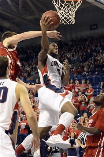 South Dakota's Tyler Flack swats at the ball as Gonzaga's Gary Bell Jr. goes for a layup, in the second half of an NCAA college basketball game, Sunday, Nov. 18, 2012, in Spokane, Wash. Gonzaga beat South Dakota 96-58. (AP Photo/Jed Conklin)