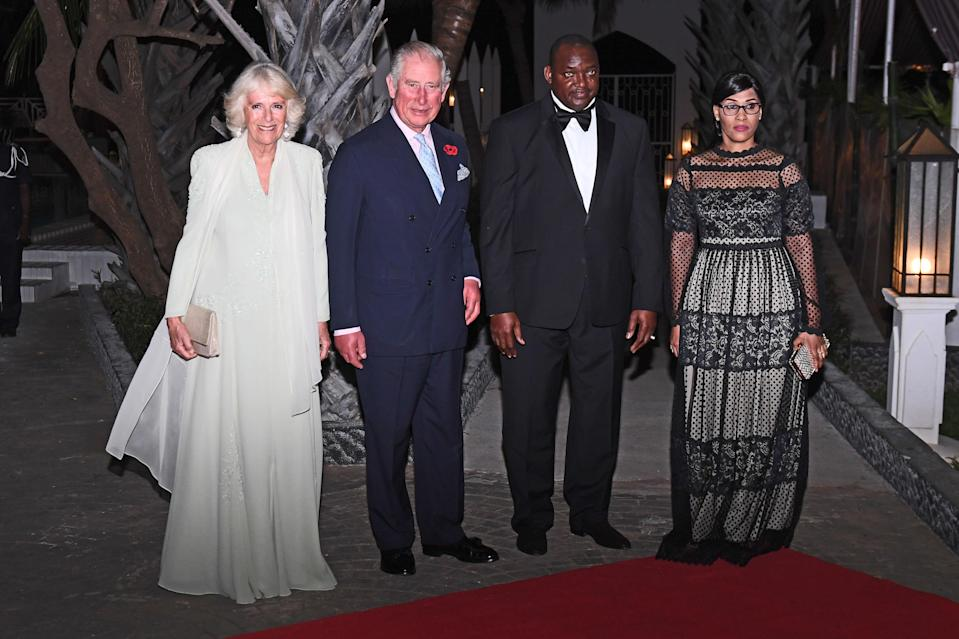 The Prince of Wales and Duchess of Cornwall with President Adama Barrow and his wife arrive at the state dinner (PA)