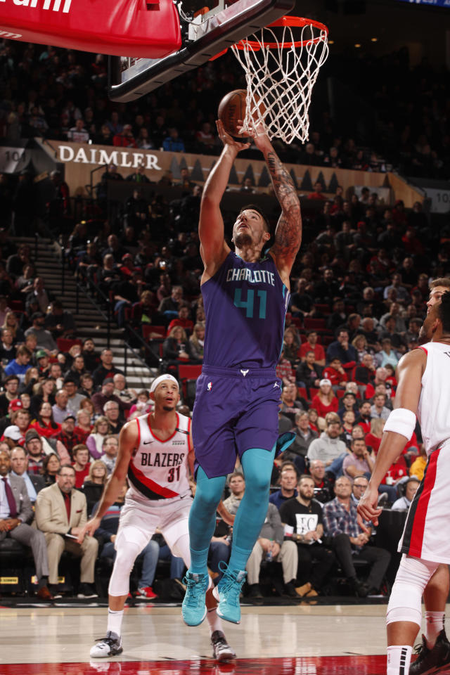 PORTLAND, OR - JANUARY 11: Willy Hernangomez #41 of the Charlotte Hornets shoots the ball against the Portland Trail Blazers on January 11, 2019 at the Moda Center Arena in Portland, Oregon. (Photo by Cameron Browne/NBAE via Getty Images)