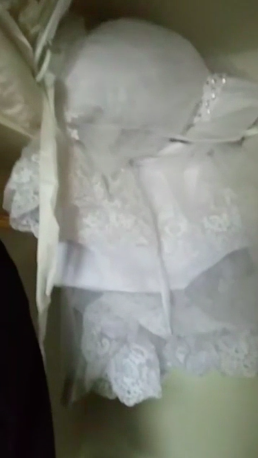 A screenshot from Parry's Facebook Live video, showing the wedding dress still dry inside the closet.  (Kyle Parry)