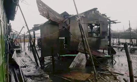 A damaged house is seen after Typhoon Mangkhut hits Philippines, Bolinao, Pangasinan, Philippines September 15, 2018 in this still image obtained from a social media video. DAEVE DEL FIERRO/via REUTERS