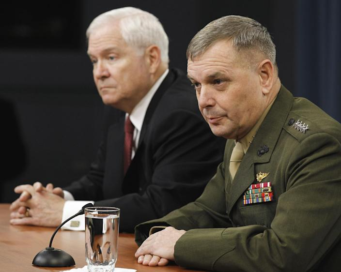 Defense Secretary Robert Gates, left, and then-Joint Chiefs Vice Chairman Gen. James Cartwright take part in a briefing at the Pentagon. (Photo: Alex Brandon/AP)