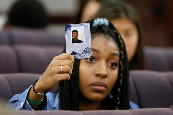 <p>Tyra Hemans, a senior from Marjory Stoneman Douglas (MSD) High School, holds a photo of her friend Joaquin Oliver, who died during last week's mass shooting on her campus, as she and other MSD students speak with the leadership of the Florida Senate, at the Capitol in Tallahassee, Fla., Feb. 21, 2018. (Photo: Colin Hackley/Reuters) </p>