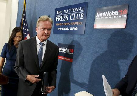 Senator Jim Webb leaves after a news conference in Washington