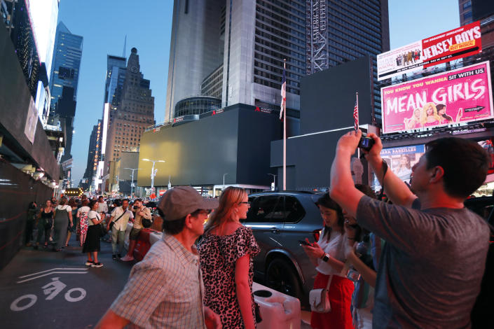 Screens in Times Square are black during a widespread power outage, Saturday, July 13, 2019, in New York. (Photo: Michael Owens/AP)