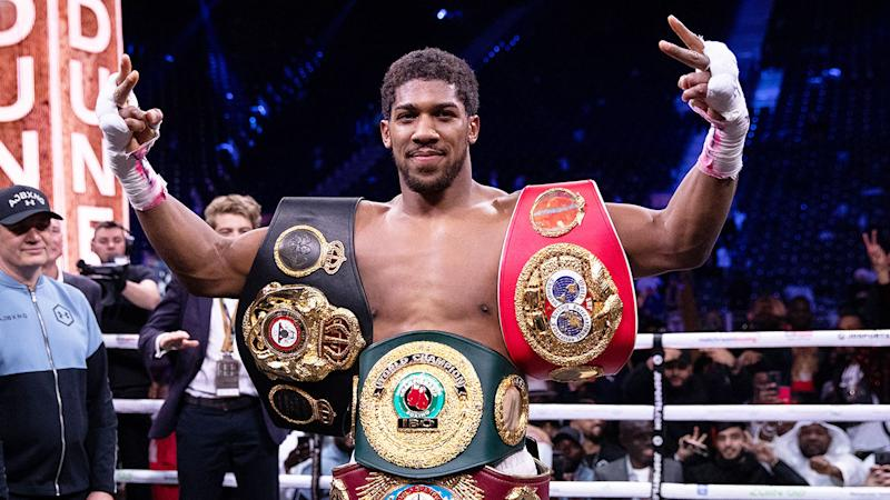 Pictured here, Anthony Joshua with the belts he regained in the Andy Ruiz Jr. rematch.
